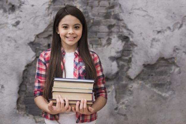close-up-positive-young-girl-holding-pile-books_23-2148464493